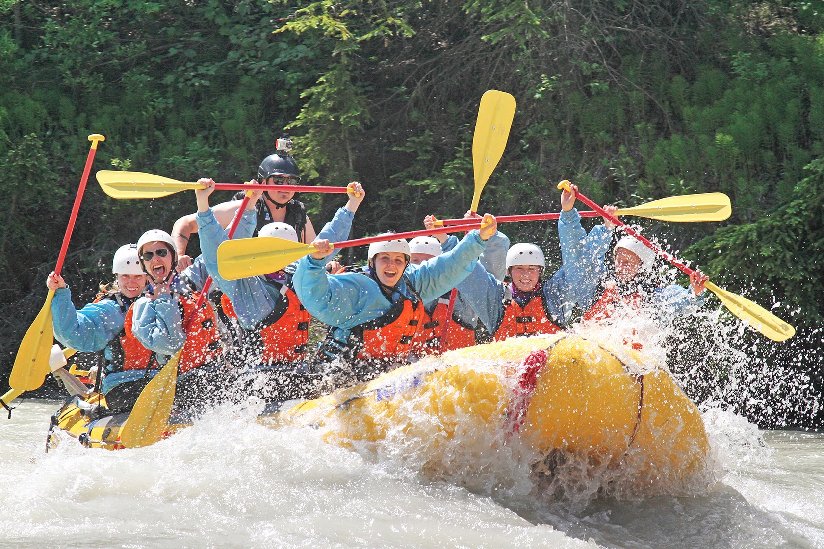 A bachelorette party loving their white water rafting trip