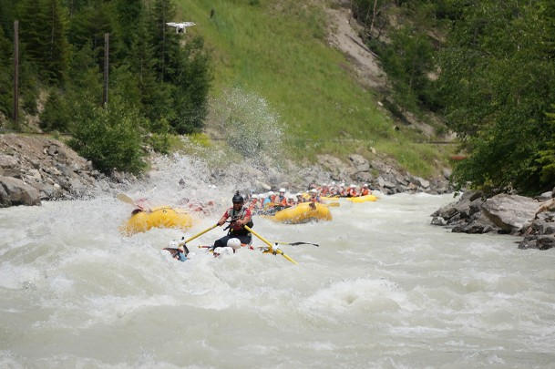 A team of rafters coming through Roller Coaster rapids.