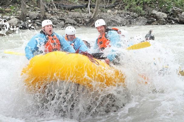 Raft hitting big rapid on Kicking Horse River