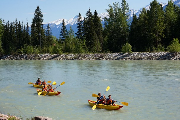 A family kayaking on the Kicking Horse River in Golden BC