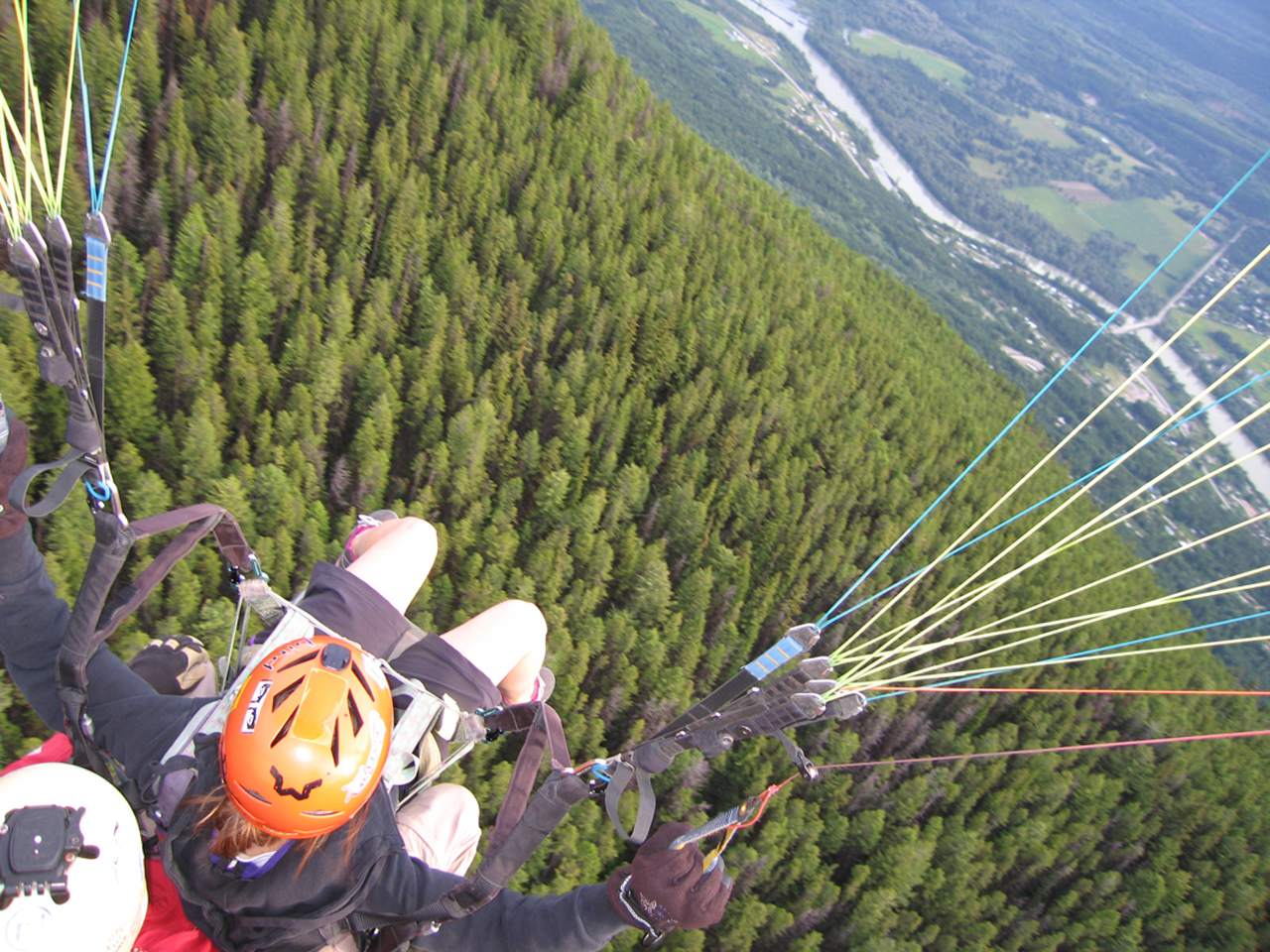 Girl paragliding in Golden, British Columbia