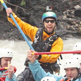 A boatload of guests loving their rafting trip with Glacier Raft Company