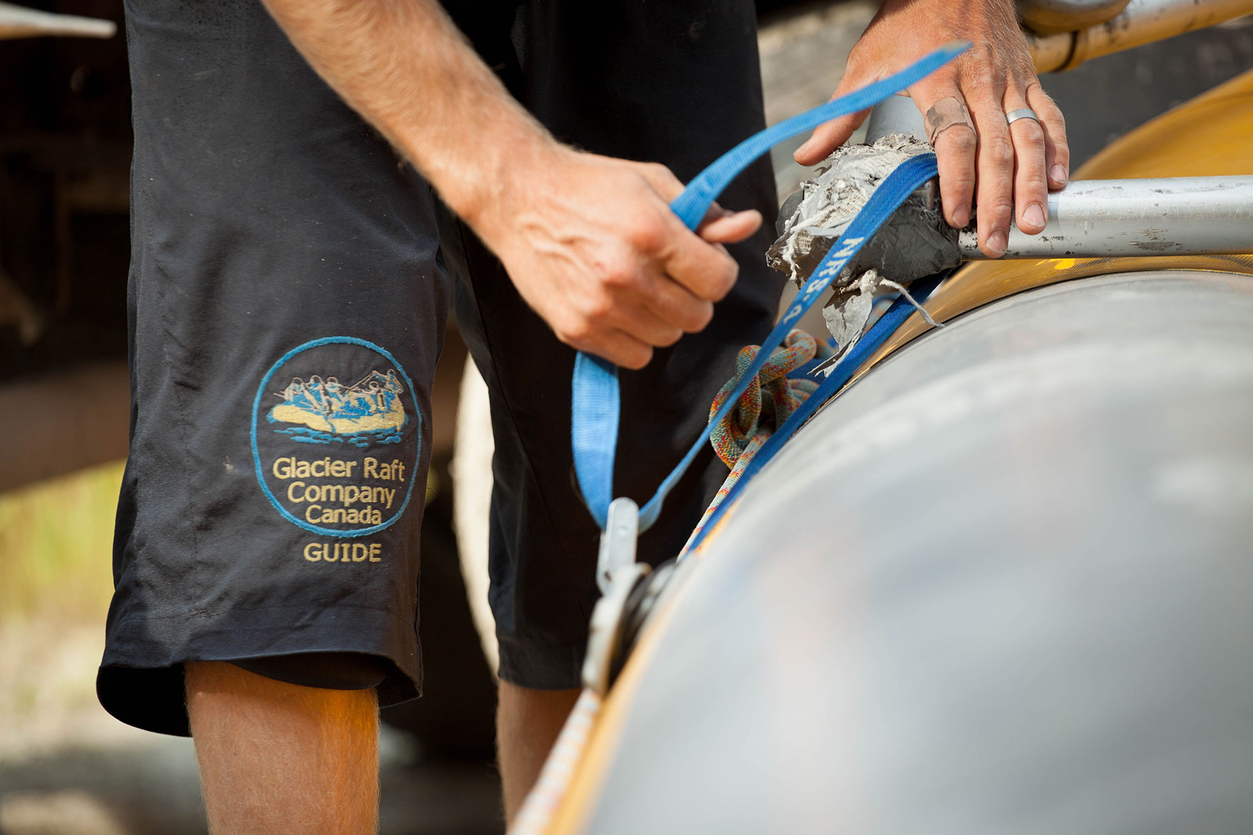 A Glacier Raft Company guide prepping a raft to be put on water