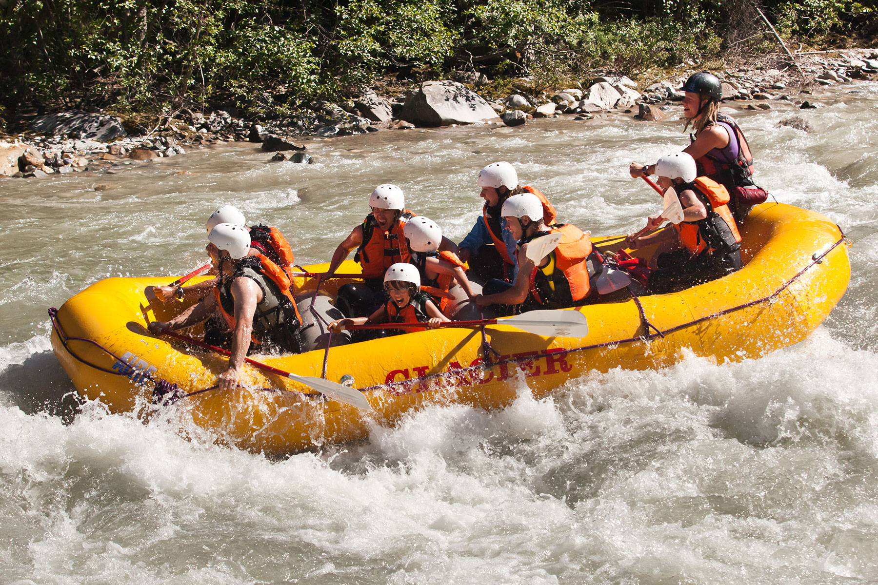 A smiling family on their rafting trip
