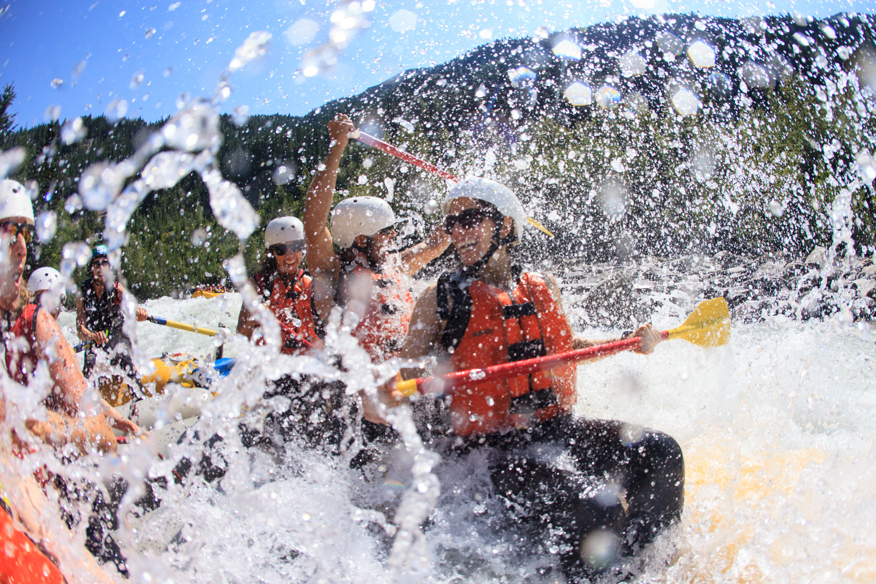 Smiling guests and big splash with Glacier Raft Company