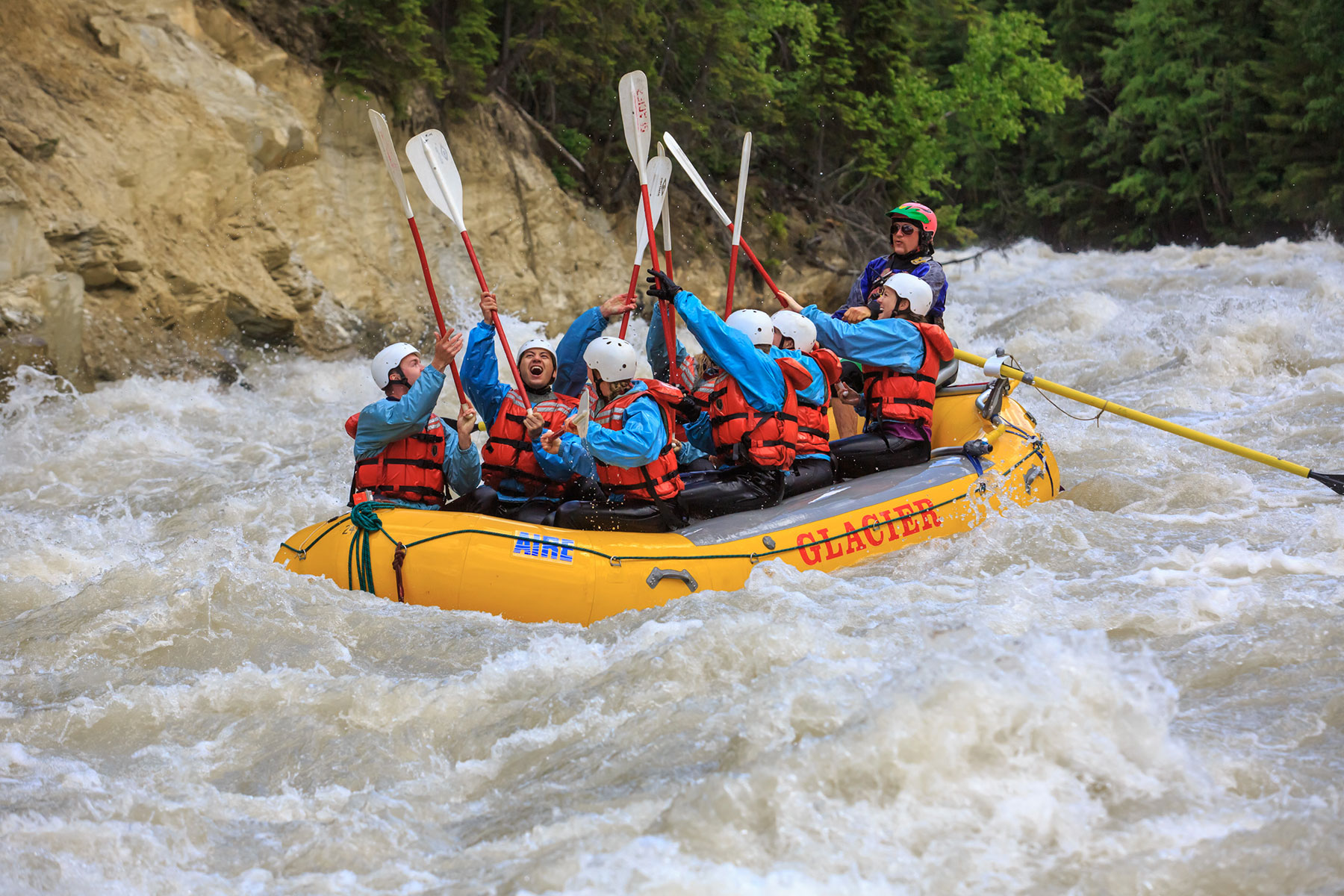 Guests giving a paddle high five on the Kicking Horse River