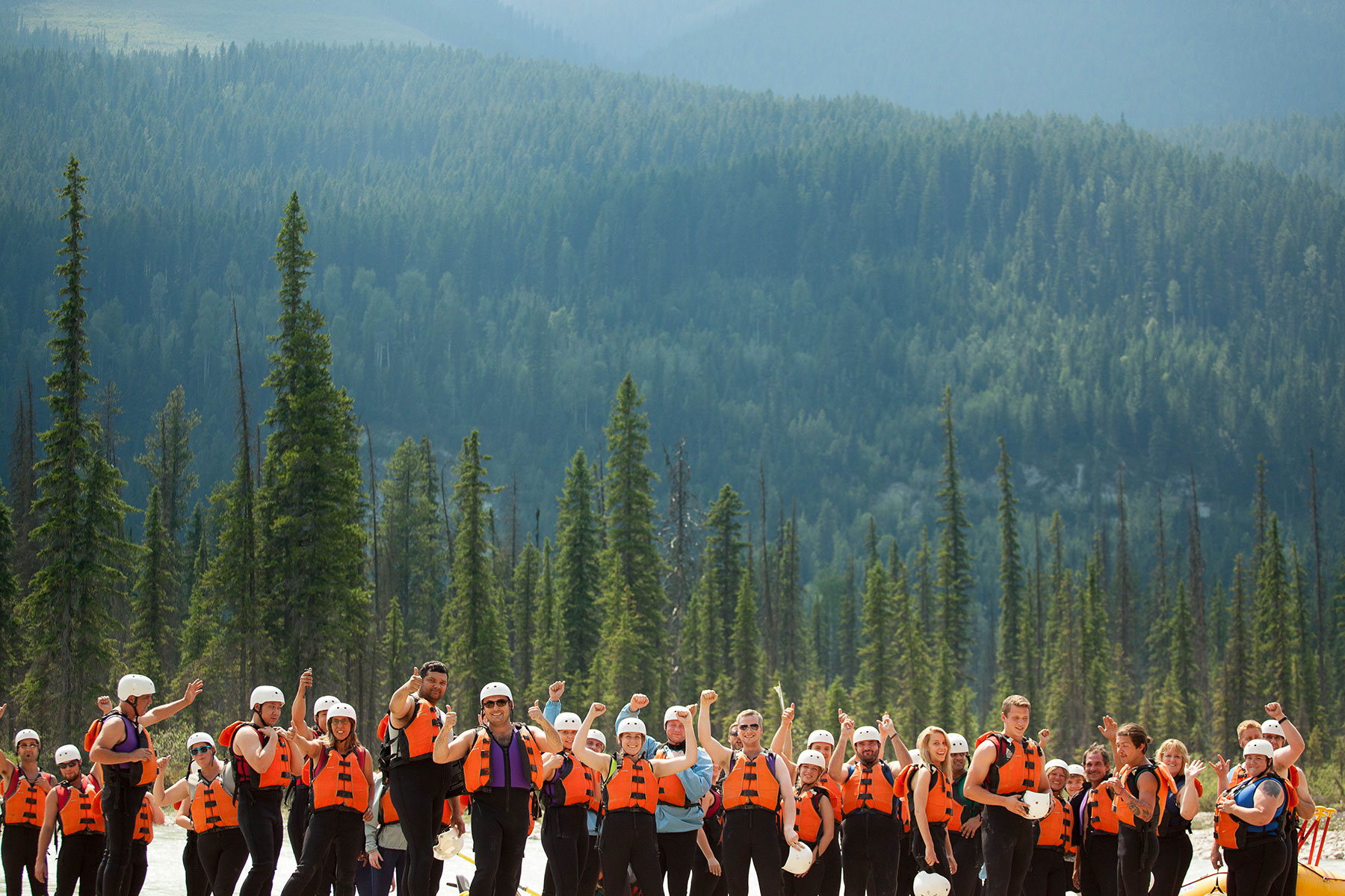 Many of Glacier Raft Company's guests giving a thumbs up