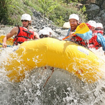 Excited faces as they hit a big rapid