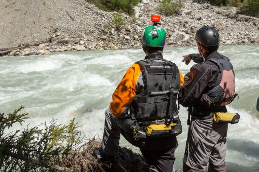 Two guides scouting the White River in British Columbia