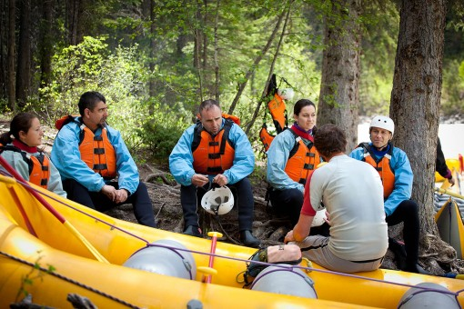 Guests listening to a safety talk before starting whitewater rafting in Golden BC