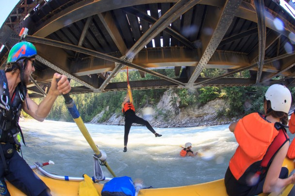 Hanging off the bridge in the Kicking Horse River