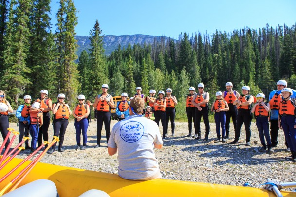 Glacier Raft Company guide giving a safety talk before the rafting trip begins