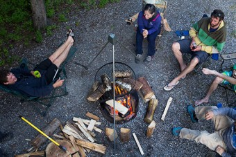 Guests relaxing as their bbq dinner cooks on the White River 2 Day Rafting Trip