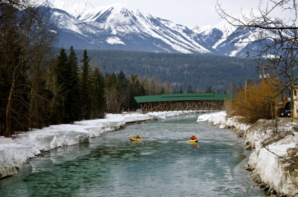 Kayaking towards the Timber Frame Pedestrian Bridge in Golden, British Columbia