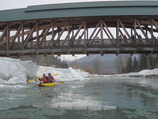 Kayaking underneath the Timber Frame Pedestrian Bridge in Golden British Columbia