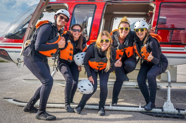 Friends ready to heli raft the lower canyon of the Kicking Horse River