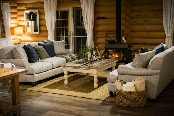 Relax by the fireplace at Whitewater Lodge B&B
