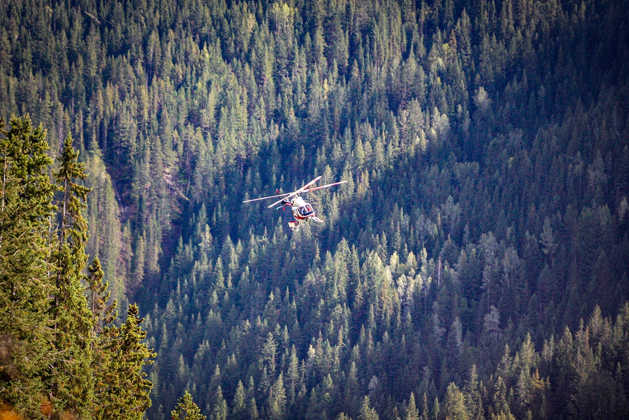 Helicopter flying into Lower Canyon of Kicking Horse River