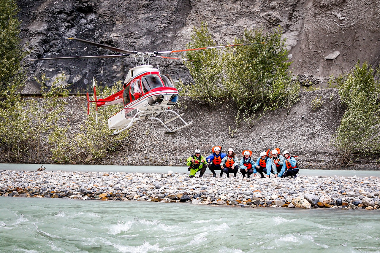 Helicopter flying rafters to Kicking Horse River Lower Canyon