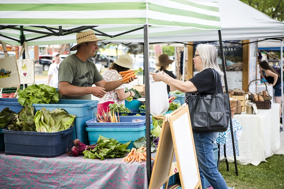 Buying veggies at farmers' market in Golden BC