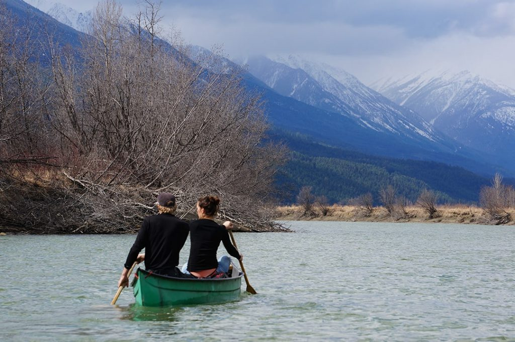 2 people paddling a canoe on Columbia River in Columbia Wetlands