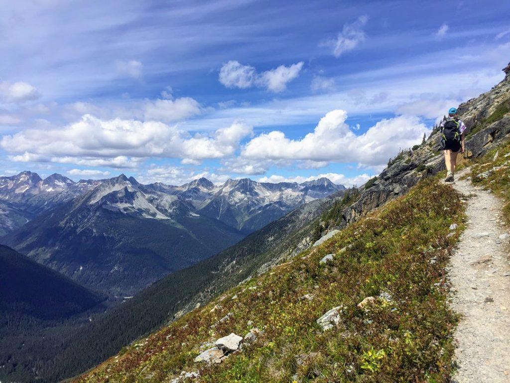 Girl hiking in the alpine in Glacier National Park, BC
